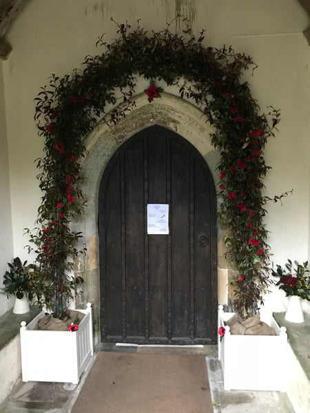 Church door wedding arch