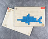 Dolphin pentomino puzzle in packaging