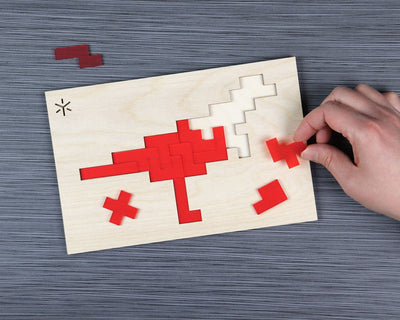 T-rex pentomino puzzle in packaging