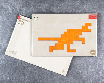 Velociraptor pentomino puzzle in packaging