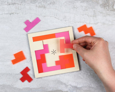 Candy square pentomino puzzle in packaging