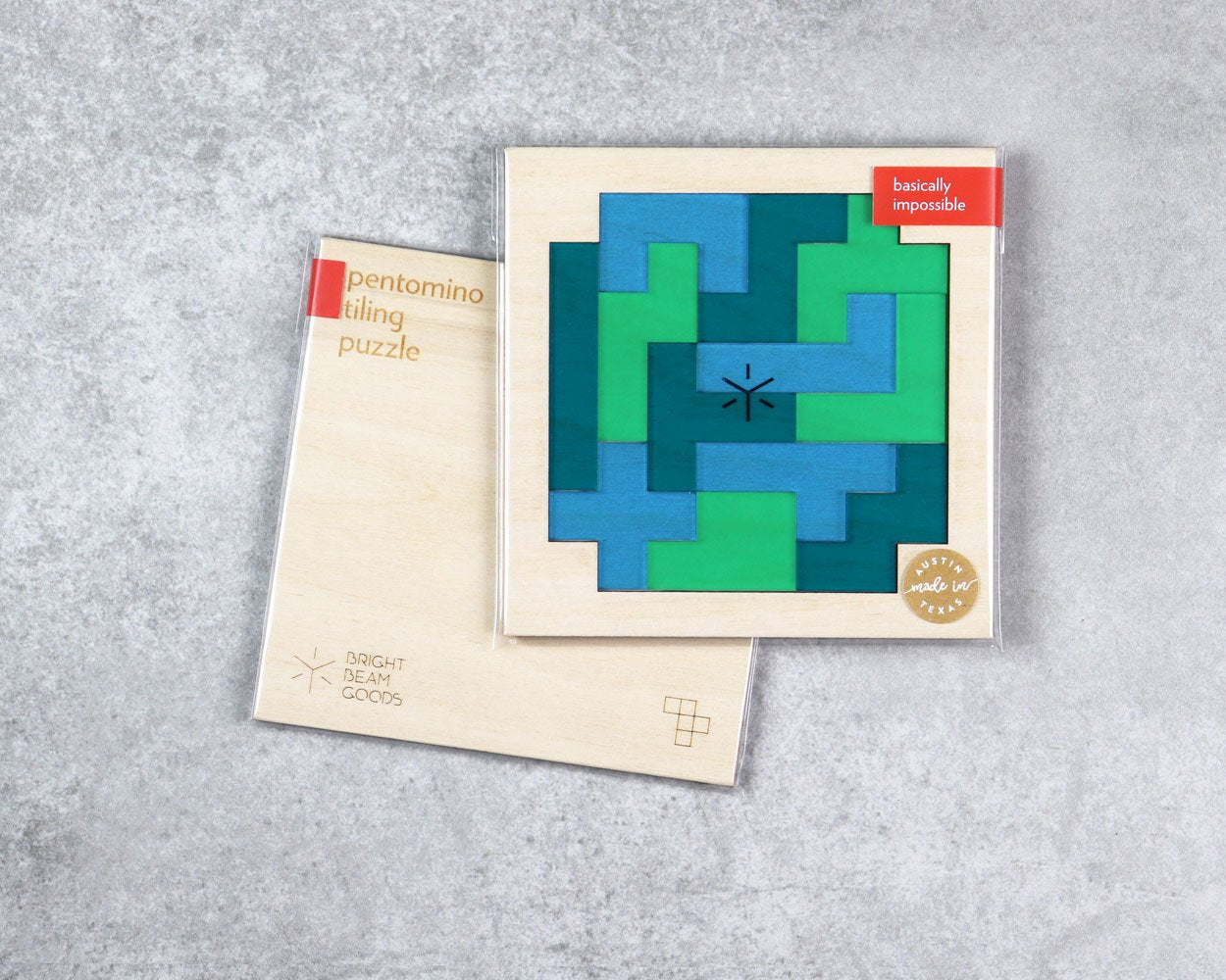 Earth square pentomino puzzle in packaging