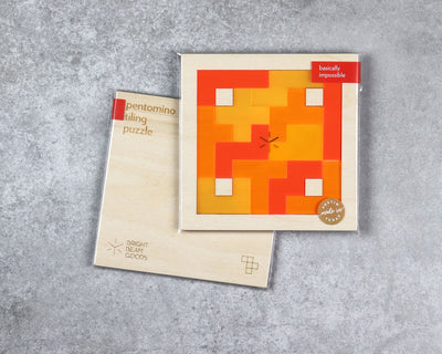 Flame square pentomino puzzle in packaging