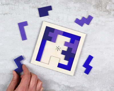 Plum square pentomino puzzle in packaging