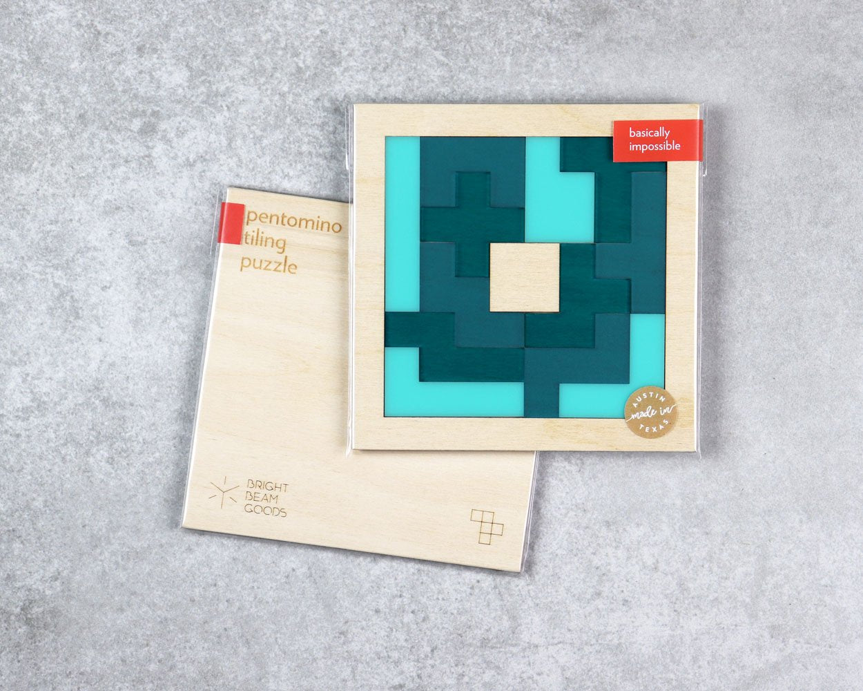 Sea square pentomino puzzle in packaging
