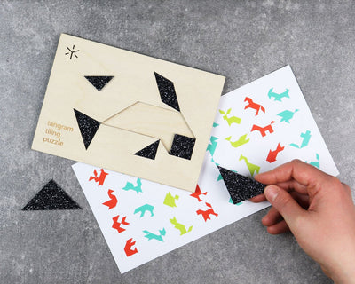 Unpackaged orca tangram puzzle