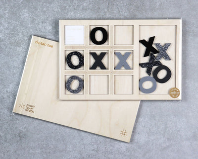 Stardust tic-tac-toe game in packaging