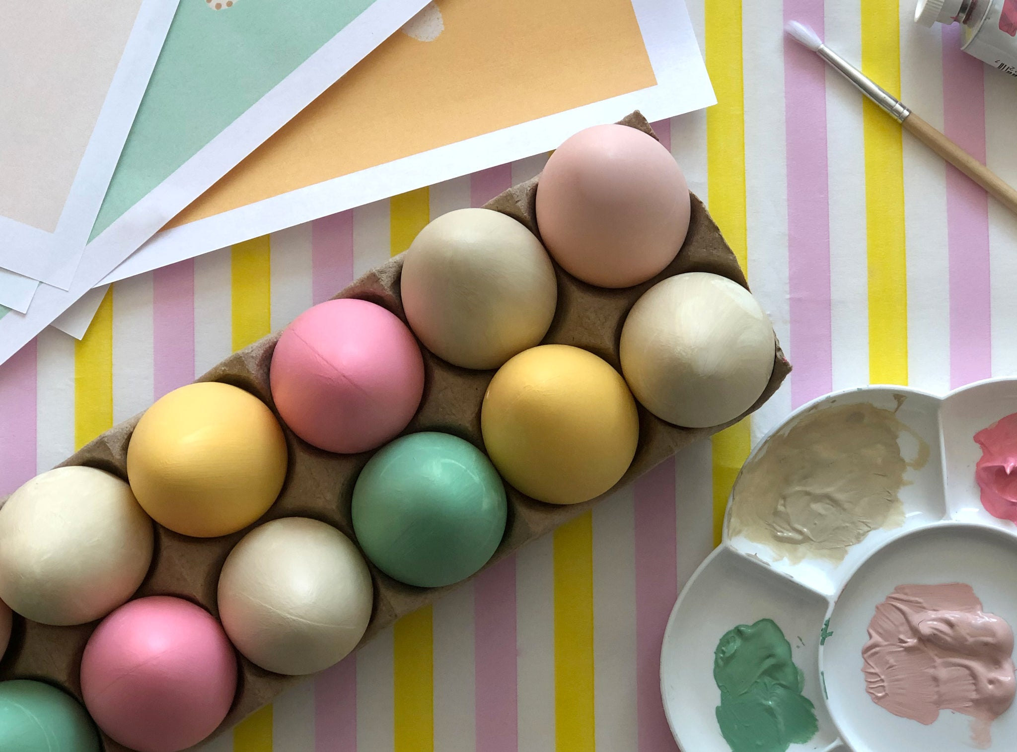 Various colour painted Easter egg crafts for kids