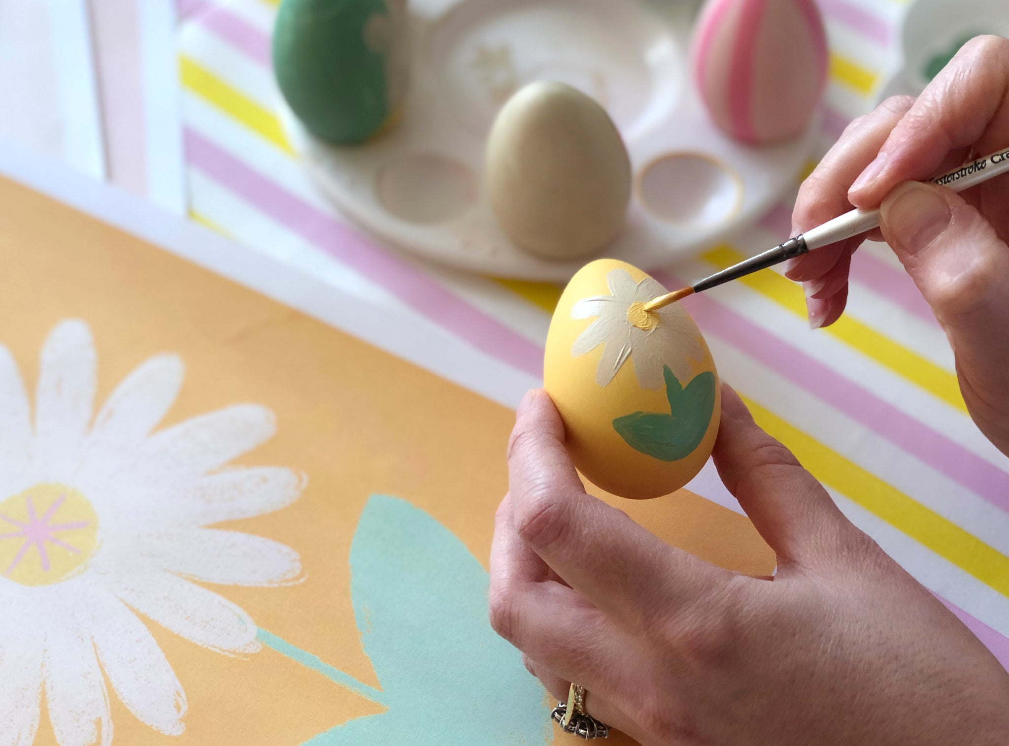 Painted daisy on Easter egg craft for kids