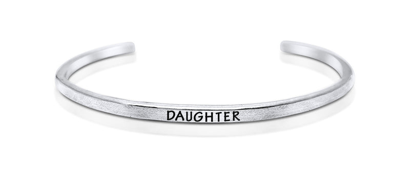 "A handmade and handstamped ARGENTIUM STERLING SILVER bracelet with ""daughter"" written on it waiting to be bought"