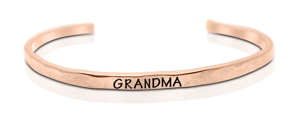 "A handmade and handstamped COPPER bracelet that has the word ""grandma"" written on it waiting to be bought"
