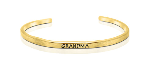 "A handmade and handstamped GOLD COLOURED bracelet with the word ""grandma"" written on it waiting to be bought"