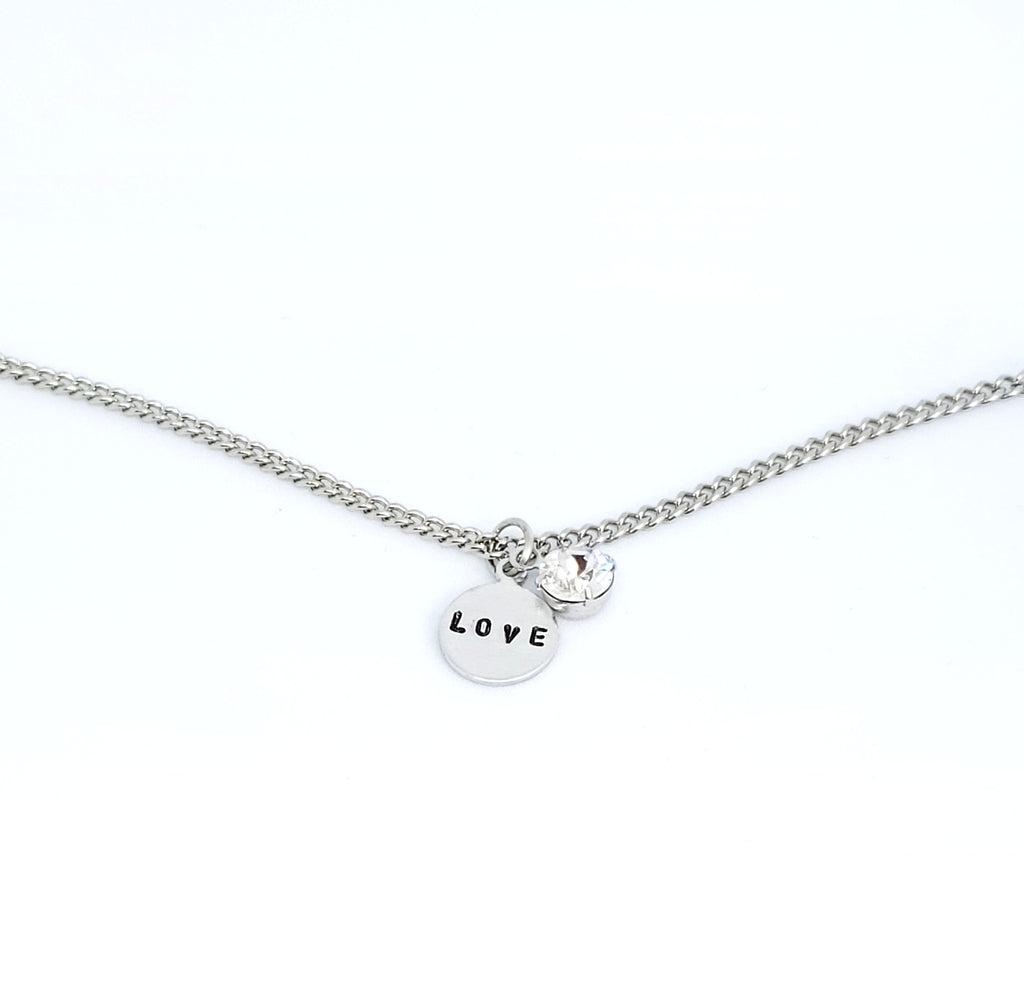 A handmade necklace with stamped word 'Love' with Swarovski Crystal