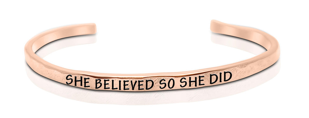"A handmade and handstamped COPPER bracelet that has the word ""she believed, so she did"" written on it waiting to be bought"
