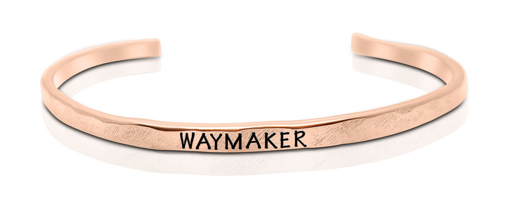 "A handmade and handstamped COPPER bracelet that has the word ""waymaker"" written on it waiting to be bought"