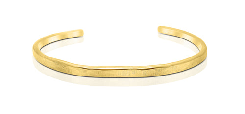 A handmade and hammered GOLD COLOURED bracelet that is perfect for stacking other bracelets with, it waiting to be bought