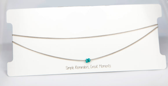 A handmade choker with a Duo Sea Blue Bead