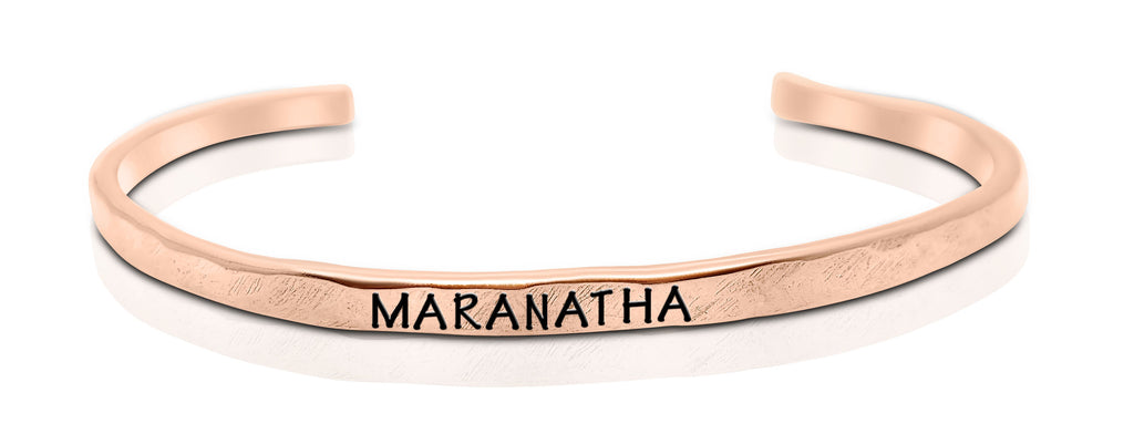 "A handmade and handstamped COPPER bracelet that has the word ""maranatha"" written on it waiting to be bought"