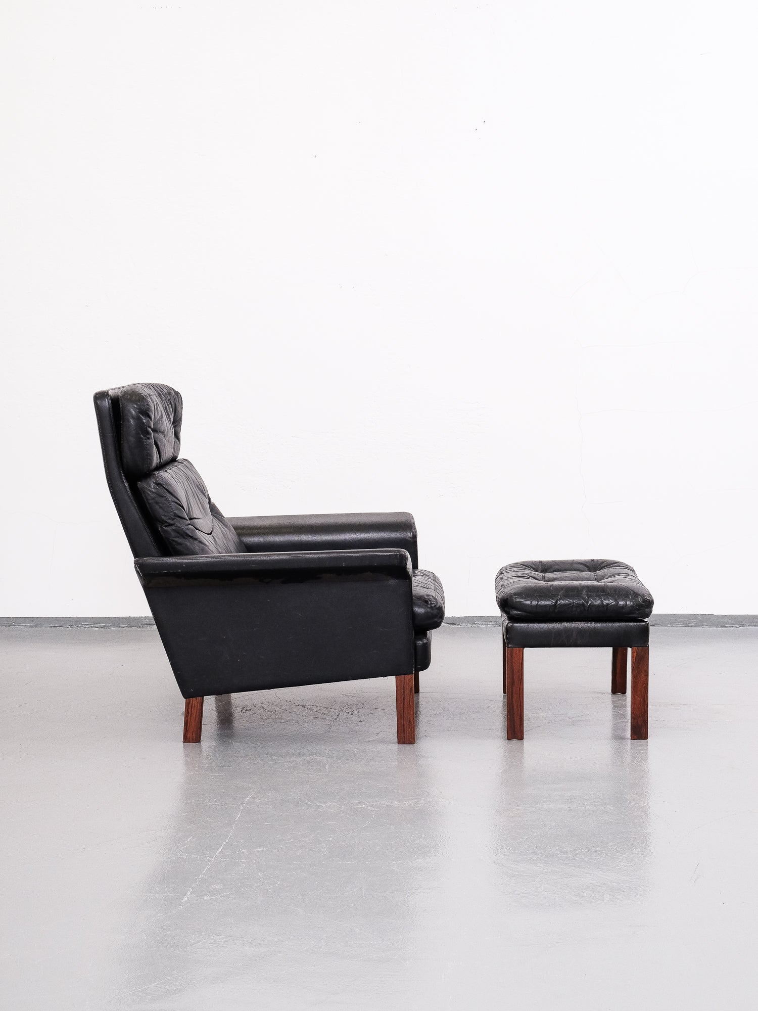 Midcentury Black Leather Highback Lounge Chair and Ottoman, 1960s