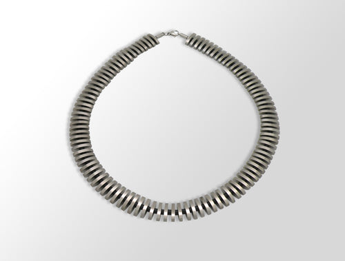 CHARIZZMA CHIP ART STEEL NECKLACE - Joryel Vera Jewelry