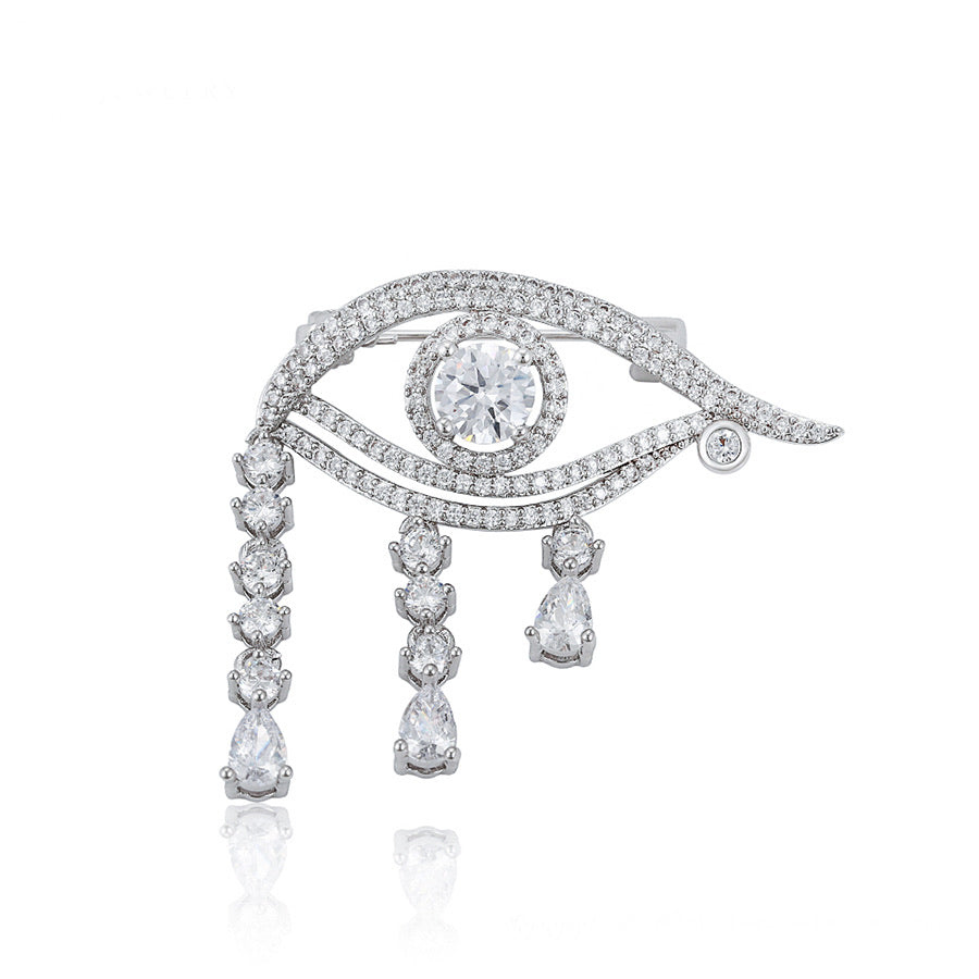 Rhodium Plated Diamond Eye Brooch