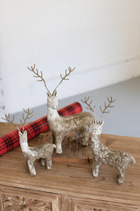 Painted clay deer with wire antlers