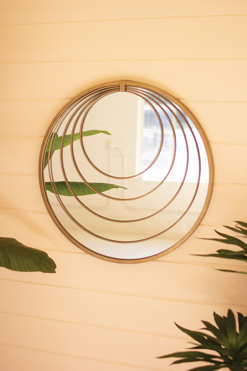 antique brass mirror with multiple rings