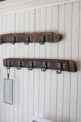 recycled wood coat rack with five wire hooks