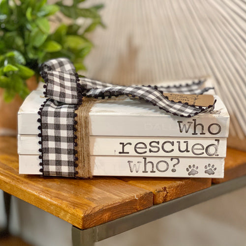 Who Rescued Who Book Stack