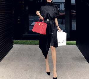 ASYMMETRICAL BLACK PUFF DRESS