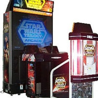 "Star Wars Trilogy Arcade cabinet by Sega, featuring a full 50"" rear-projection screen and seated controls."