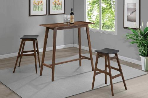 The perfect fit bar height table. Offers an inviting space to gather without taking up a lot of space. The table features rounded edges, tapered legs, and is constructed with solid hardwood, walnut veneer and finished natural walnut hardwood. Complete the look with the available matching backless bar stool featuring walnut finish and dark grey, faux leather upholstered seat.