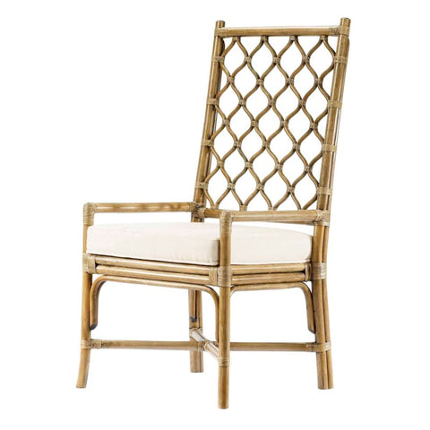 The tall-backed Ambrose Arm Chair, featuring Berber-inspired lattice work, is comfortable to lean against and creates a sense of airiness in any space. Works well with rattan tables and complements most wood finishes for a unique dining environment.