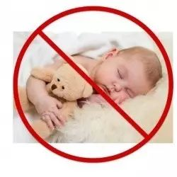baby with teddy and furry blanket which is not recommended