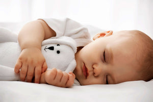 baby sleeping on a healthier safer cot mattress from Pure Zees