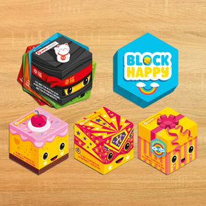 Block Happy cards laid on a wooden table