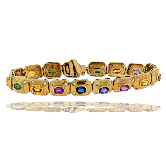 Rainbow Sapphires, Bezel Diamond, 18 TCW Bracelet, 18Kt. Diamond quality are SI1-VS2 clarity and G-H color.