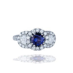 14 karat white gold tanzanite ring with crescent shaped diamonds, halo ring