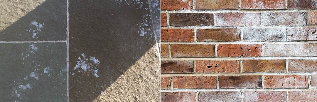 Efflorescence on natural stone and on a brick wall