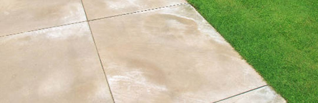 Efflorescence on a patio next to a lawn