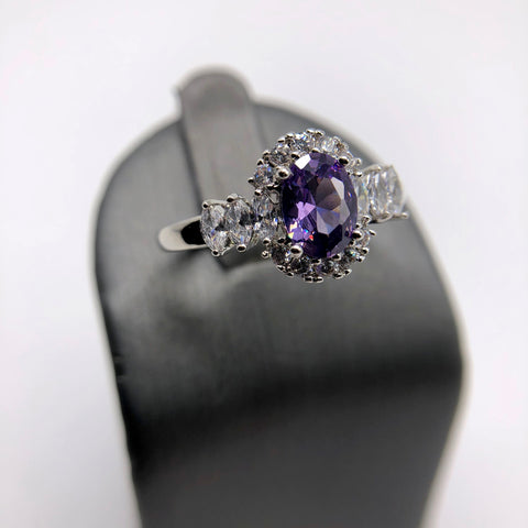 PURPLE STONE WITH CLEAR CZ SET IN RHODIUM