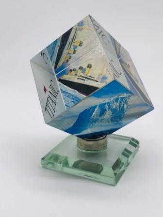 SPINNING CRYSTAL CUBE ON A STAND
