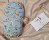 Small Oval Embroidered Clutch