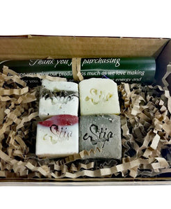 kraft box with four travel soaps, all natural, olive oil soaps with Estia soaps stamp and a thank you note. Handmade in Scotland, UK