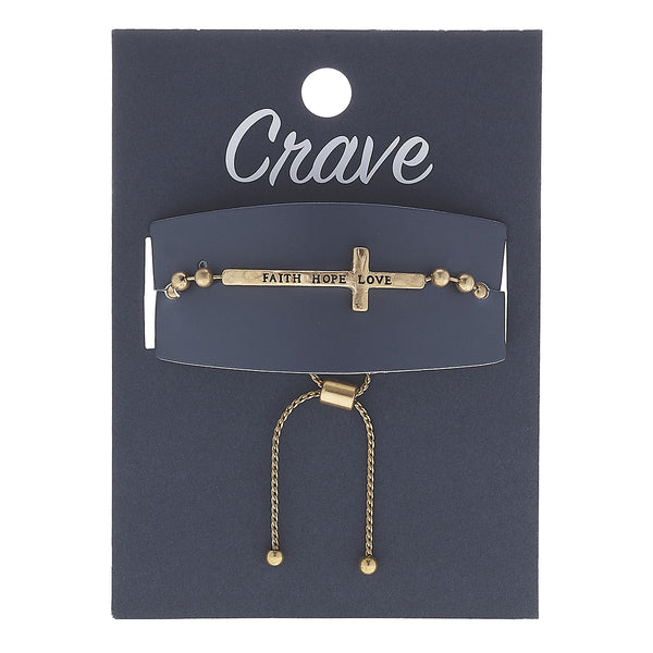 """Faith Hope Love"" Cross Bolo Bracelet in Worn Gold by Crave"