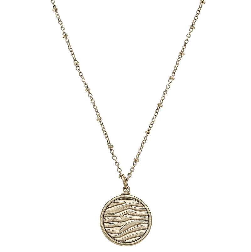 Metal Animal Print Disc Necklace in Worn Gold by Crave