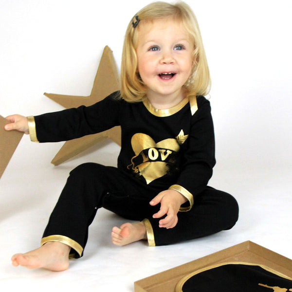 gold and black love onesie