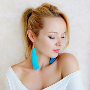 Girl Wearing Blue Tassel Earrings