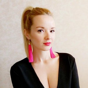 Girl Wearing Pink Tassel Earrings