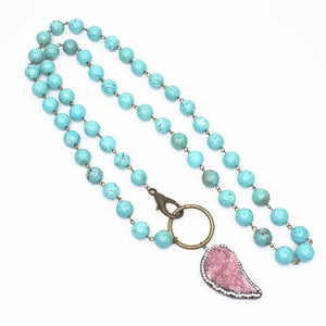 pink druzy wing on turquoise beads